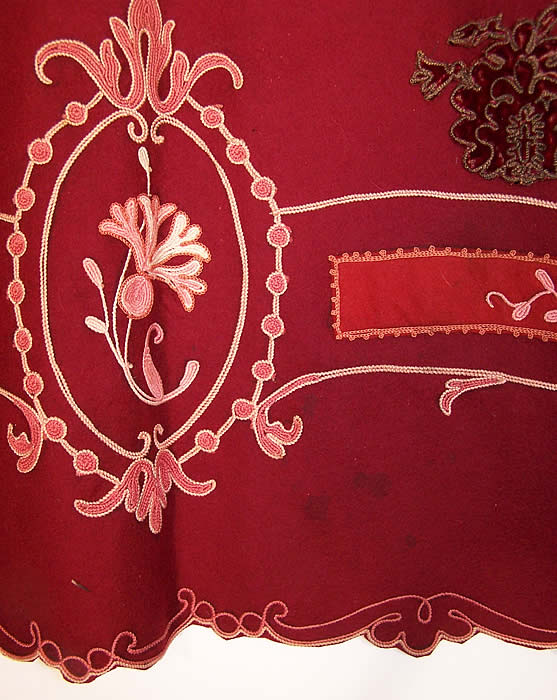 The Gallery of Wearable Art Burgundy Wool Embroidered Coat  Close up.