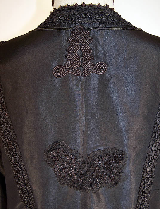 Edwardian Black Silk Taffeta Soutache Trim Walking Suit Jacket back a small patched repair on the back which has been covered with a black lace applique close up.