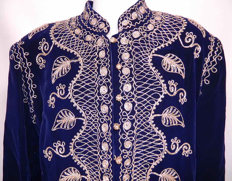 Vintage Adonis Lebanon Blue Velvet Gold Embroidered Boho Kaftan Robe Coat.The kaftan measures 55 inches long, with 44 inch hips, a 42 inch waist, 38 inch bust, 16 inch back and 21 inch long sleeves. It is in good condition. This is a wonderful piece of wearable Lebanese textile art!