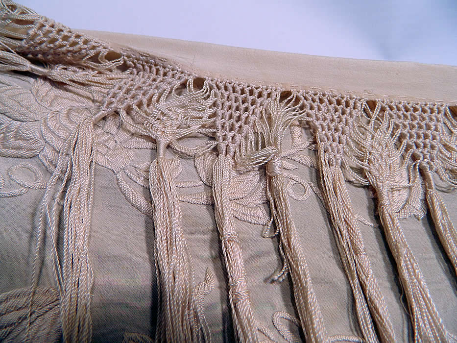 Antique Cream White Silk Embroidered Floral Canton Wedding Piano Shawl. It is in good condition, with only a few small faint age spots stains. This is truly a rare and wonderful piece of wearable textile art!