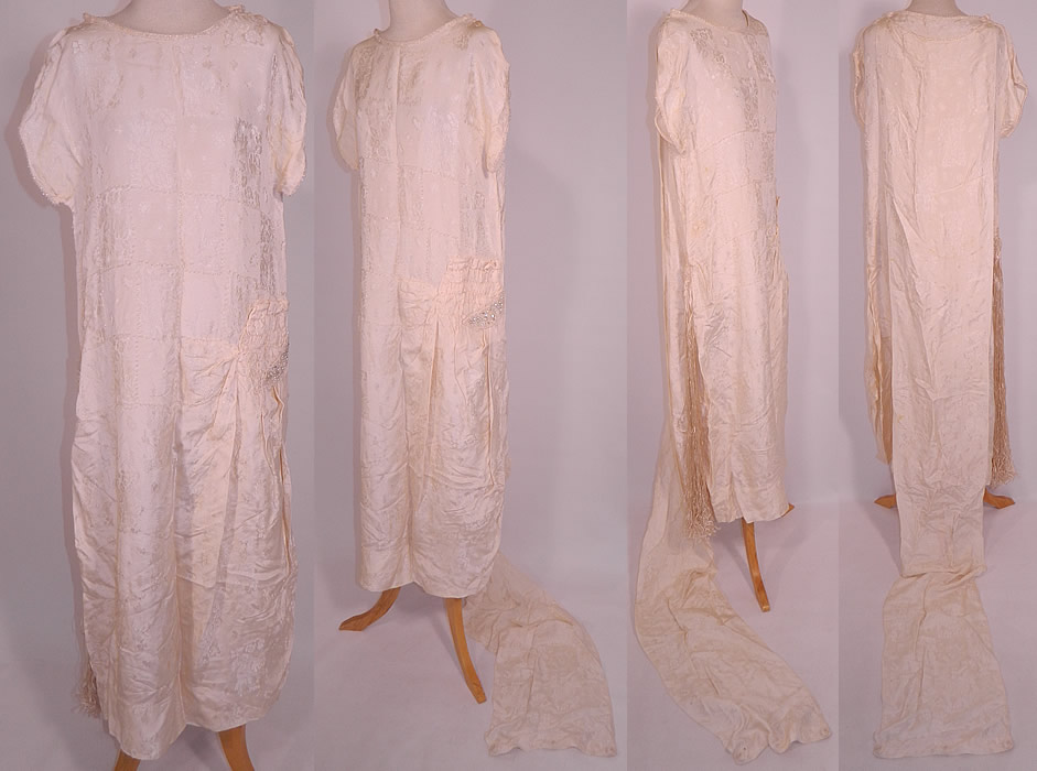 Vintage White Silk Damask Beaded Bridal Wedding Watteau Train Gown Dress. This vintage white silk damask beaded bridal wedding watteau train gown dress dates from the 1920s. It is made of an off white silk damask floral weave pattern brocade fabric, with tiny crystal beading done in a box grid design and edging.