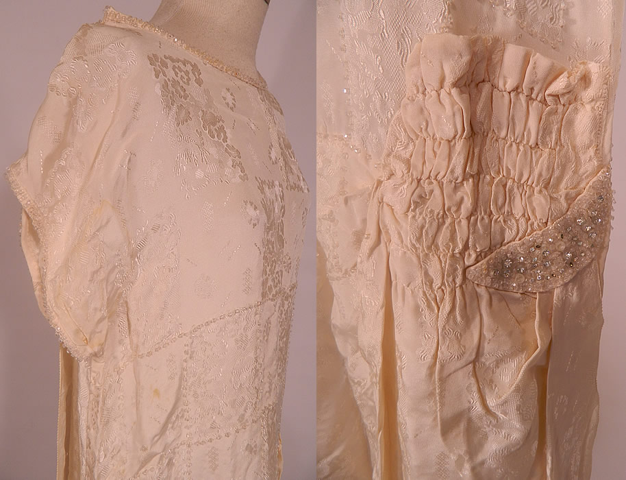 Vintage White Silk Damask Beaded Bridal Wedding Watteau Train Gown Dress. This beautiful bridal wedding gown dress has a loose fitting drop waist style, with a rounded scoop neckline, short sleeves and long silk watteau train falling from the shoulders in a draping cape style back train, with weighted bottom hem.
