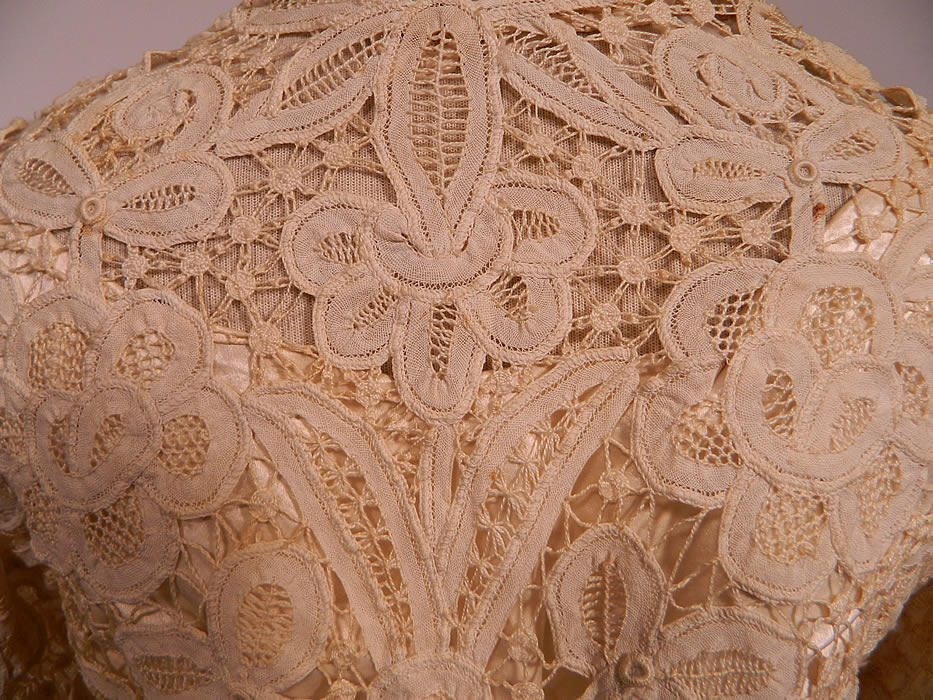 Edwardian Antique Battenburg Crochet Tape Lace Wedding Gown Dress. The skirt measures 40 inches long in the front, 45 inches long in the back, with a 34 inch waist.