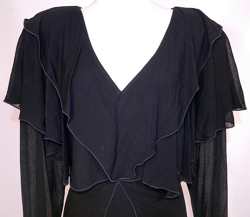 Vintage Holly Harp Layered Crepe Georgette Black Cocktail Dress. The dress measures 40 inches long, with 36 inch hips, a 32 inch waist, 36 inch bust, 18 inch back and 25 inch long sleeves. It is in good condition. This is truly a wonderful piece of quality made designer wearable art!