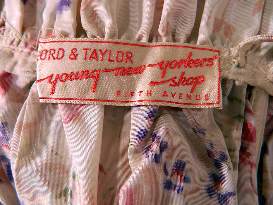"Vintage Lord & Taylor Young New Yorkers Floral Pastel Rayon Taffeta Dress Gown. There is a ""Lord & Taylor Young New Yorkers Shop Fifth Avenue"" store tag sewn inside. The dress measures 60 inches long, with a 28 inch waist and 36 inch bust. It is in good condition. This would make for a wonderful garden bridal party bridesmaid dress!"
