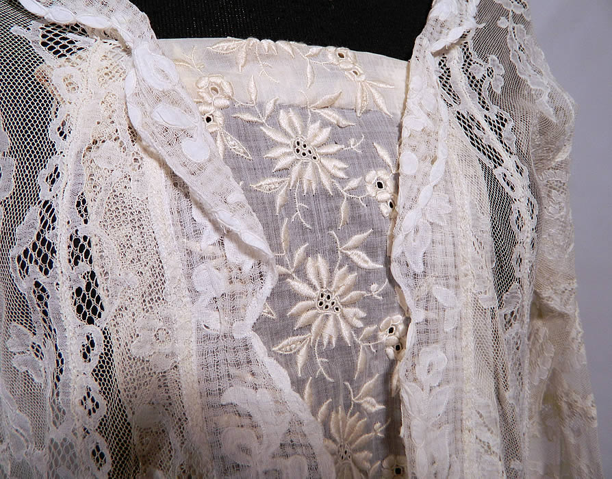Vintage Normandy Lace White Embroidered Batiste Applique Drop Waist Dress. There is valenciennes French bobbin lace and a fine windowpane mesh fabric with white cotton appliques sewn onto it.