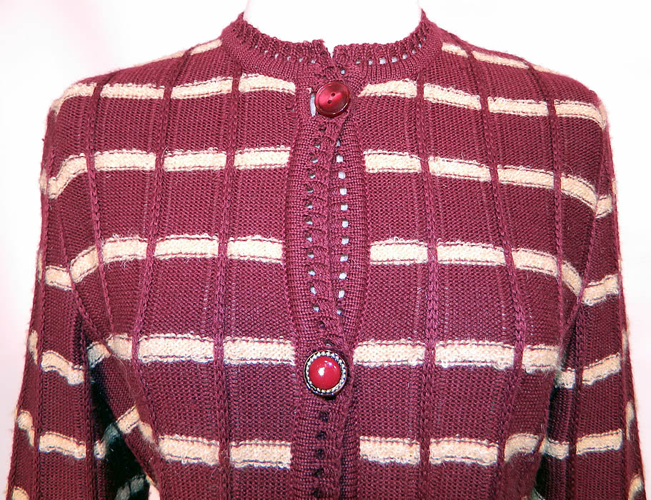 Vintage Burgundy Striped Knit Sweater Skirt Set Outfit Dress. This wonderful winter knit two piece ensemble has a cardigan sweater top with decorative button closure front, eyelet crochet knit trim edging, long sleeves and is unlined.