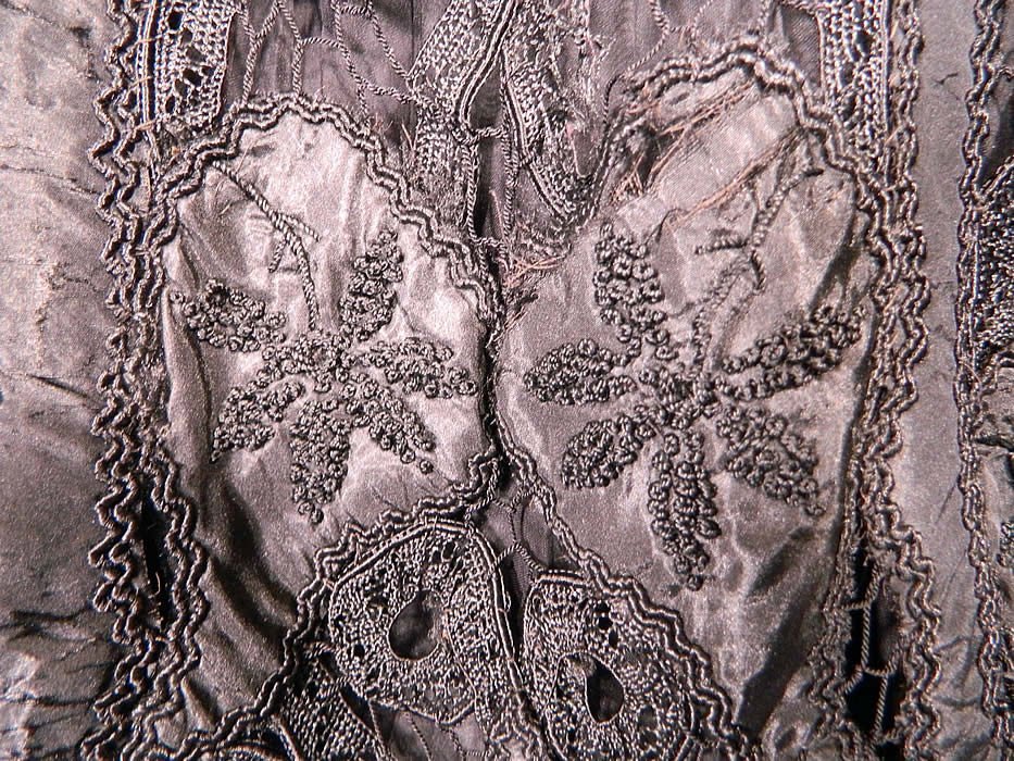 Victorian Fuchs & Rosenberger Berlin Black Silk French Knot Battenburg Tape Lace  Coat. It is in good as-is condition, with some breaks in the connecting bars lace and several small splits frays in the silk fabric.