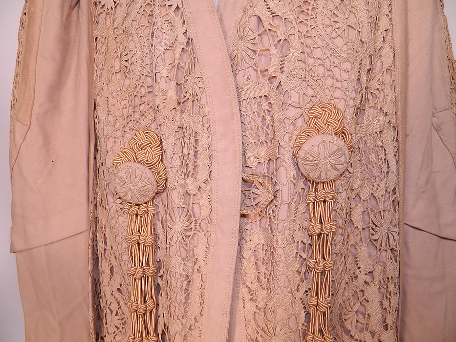 Edwardian Ecru Camel Color Wool Lace Tassel Trim Traveling Coat. This wonderful winter traveling coat has a loose fitting, floor length style, with gathered shoulders, long full mutton style sleeves, wide rolled cuffs, a fitted back and button loop front closure. It is lined in flannel for warmth, but missing the silk top lining which would have gone over it.