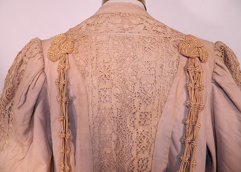 Edwardian Ecru Camel Color Wool Lace Tassel Trim Traveling Coat. It is in good condition, has not been cleaned and has a few tiny moth holes and faint age spot stains. This is truly an exceptional piece of wearable antique textile art!