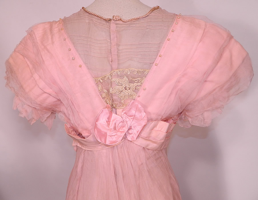 Edwardian Titanic Pink Silk Pearl Beaded Lace  Evening Gown Dress. The dress measures 54 inches long, with 36 inch hips, a 24 inch waist, 36 inch bust and 14 inch back. It is in good condition, with only some small faint age spot stains on the front and is missing a few pearl beads. This is truly a wonderful quality made piece of wearable art!