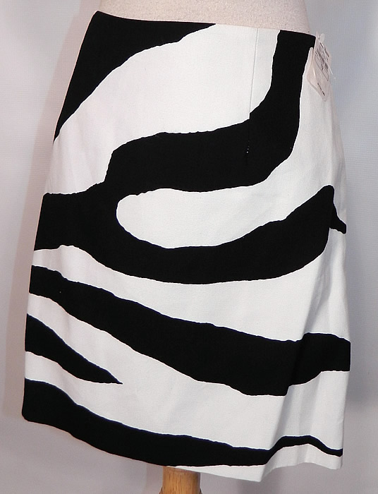 Vintage Cheap & Chic Moschino Black & White Zebra Print Suit Jacket Skirt. There is a matching fabric short mini skirt, with back zipper closure and is fully lined with same designer label sewn inside.