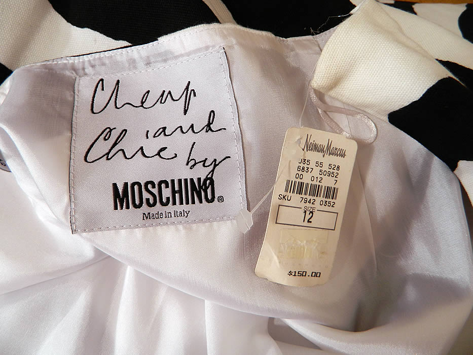 "Vintage Cheap & Chic Moschino Black & White Zebra Print Suit Jacket Skirt. There is a ""Cheap and Chic by Moschino Made in Italy"" designer label, US size 12 tag sewn inside. The jacket measures 30 inches long, with 38 inch hips, a 34 inch waist, 40 inch bust and 25 inch long sleeves."