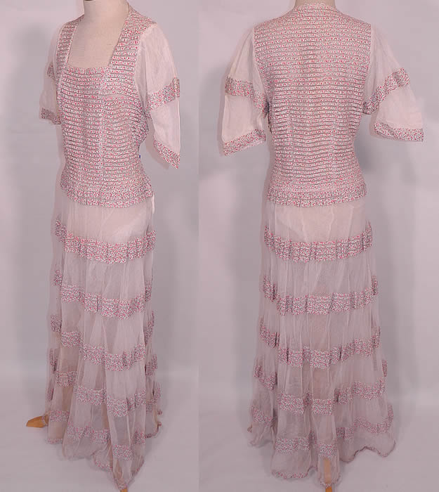 Vintage Pleated White Net Ribbon Floral  Print  Striped Trim Dress. The dress measures 57 inches long, with a 36 inch waist and 34 inch bust. The dress is in good condition. This is truly an amazing wonderful piece of wearable textile art!