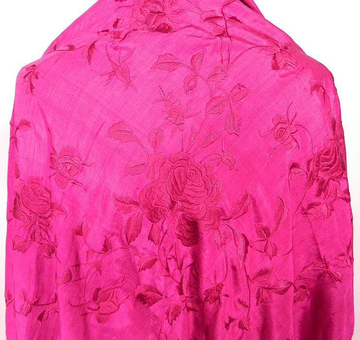 Vintage Fuchsia Purple Silk Floral Embroidered Fringe Boho Piano Shawl. There is fuchsia hand knotted macramé fine silk fringe which measures 16 inches long surrounding the entire shawl.