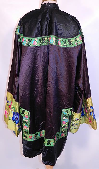 Antique Chinese  Silk Embroidered Peony Lotus Flower Sleeve Band Cuff Robe Coat. The robe measures 37 inches long, with 60 inch hips, chest, waist and a 28 inch sleeve cuff circumference.