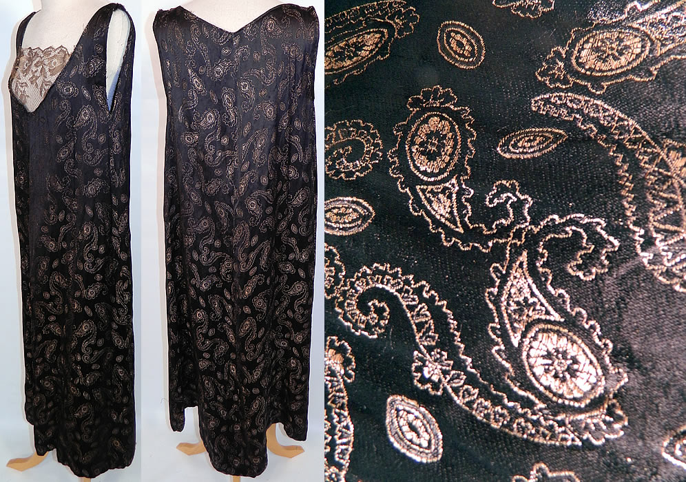 Vintage Art Deco Black Silk Gold Lamé Lace Paisley Boteh Dress Large Size. This fabulous flapper dress has a straight shift loose fitting, long drop waist style, sleeveless and unlined. The dress is a large size measuring 47 inches long, with 48 inch hips, a 42 inch waist and 38 inch bust. It is in good condition, with only a small frayed repair on one shoulder strap. This is truly a wonderful piece of wearable Art Deco textile art!