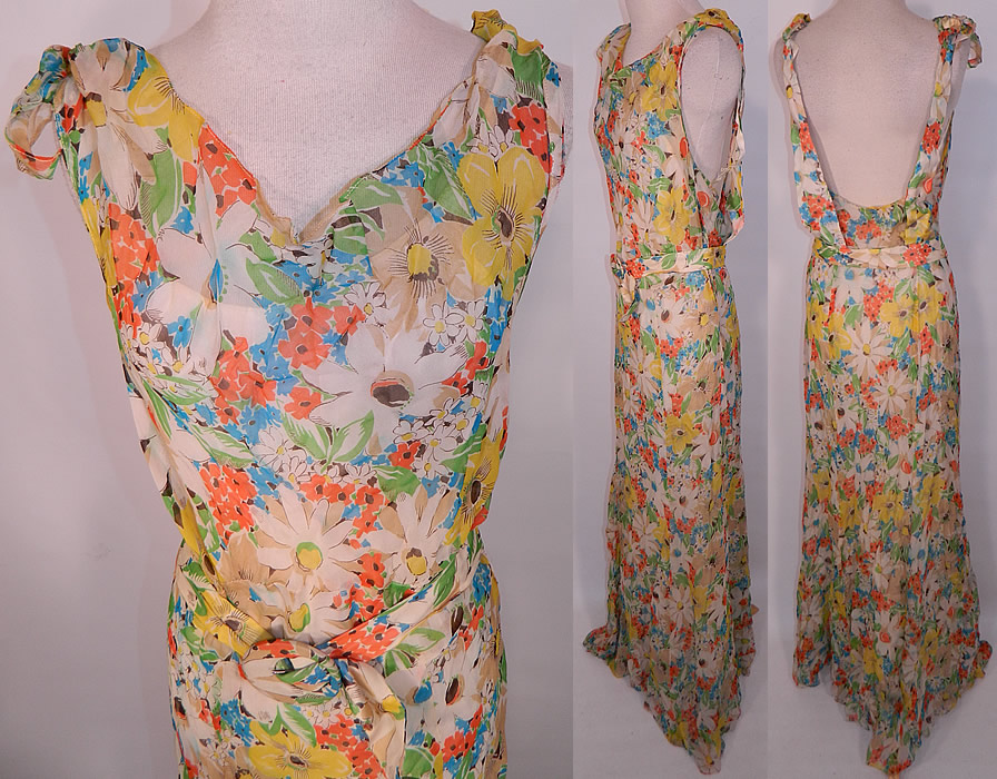 Vintage Daisy Flower Print Silk Chiffon Belted Bias Cut Dress Slip Cloak Cape. The dress measures 60 inches long, with 36 inch hips, a 28 inch waist and 34 inch bust. It is in good condition. Included is a matching fabric cloak cape, with smocking along the shoulders and a neck tie closure.