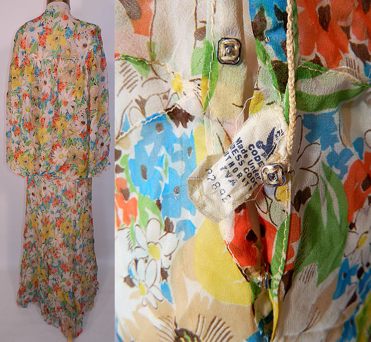 Vintage Daisy Flower Print Silk Chiffon Belted Bias Cut Dress Slip Cloak Cape. The cape measures 26 inches long, with a 80 inch bottom circumference. It is in good condition, but does have a small frayed hole on the shoulder. This is truly a rare and wonderful complete ensemble piece of wearable art!