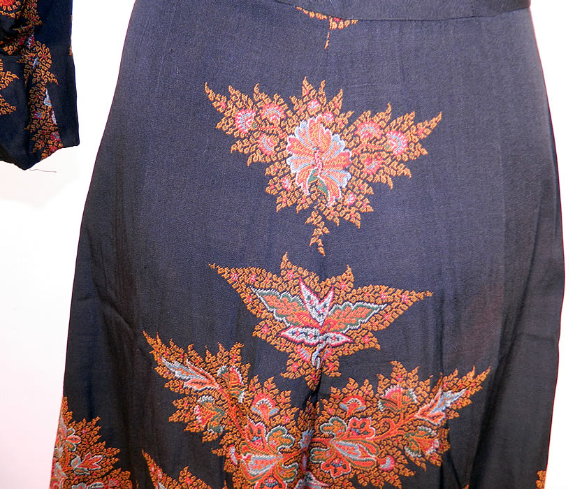 Vintage Red Orange Paisley Shawl Black Wool Dress. The dress measures 48 inches long, with 38 inch hips, a 28 inch waist, 38 inch bust, 14 inch back and 19 inch long sleeves. It is in good condition. This is truly a wonderful one of a kind wearable piece of paisley textile art!