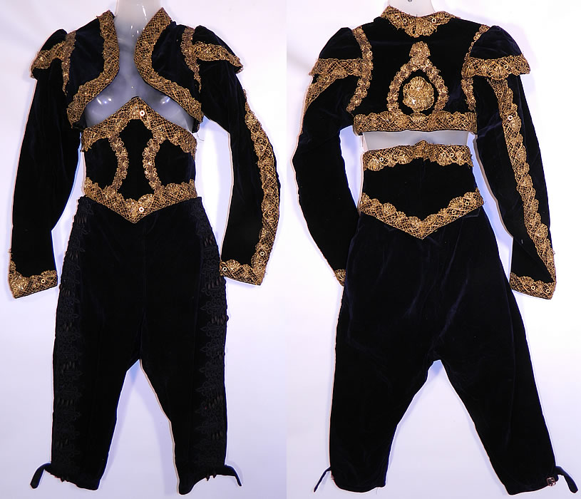 Vintage Spanish Matador Bullfighter Bolero Jacket Knickers Waist Cincher Costume. This antique Spanish matador bullfighter bolero jacket, knickers, waist cincher three piece costume dates from 1900. It is made of a black velvet fabric, with gold metallic lace sequin trim and black lace applique, silk ball fringe trim on the pants.