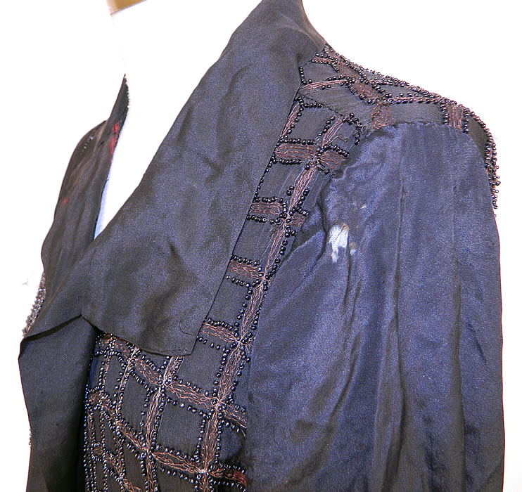 Vintage Art Deco Black Silk Gold Lamé Beaded Grid Evening Flapper Coat Jacket. It is in as-is fair condition, with  some staining, tarnish discoloration under the arms and in areas, with several tiny pin holes scattered throughout and a few small frayed holes on the shoulder (see close-up). This is truly a wonderful piece of wearable Art Deco textile art which would be great for design!
