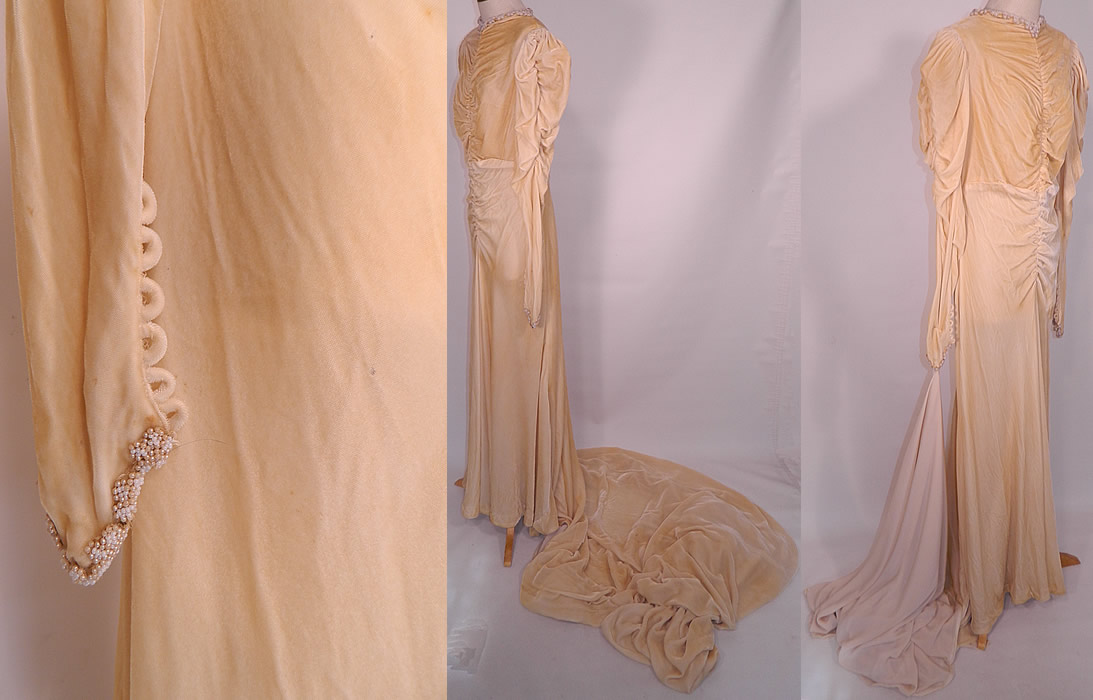 Vintage Pearl Beaded Cream Silk Velvet Bias Cut  Wedding Gown Dress Long Train Skirt. The dress measures 65 inches long in the front, with an additional 70 inch long train on back, 38 inch hips, a 30 inch waist, 36 inch bust and 29 inch long sleeves.