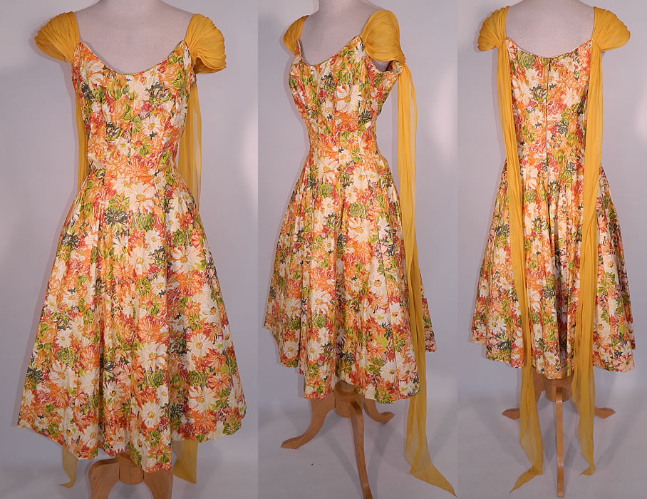 Vintage Edson's Hotel Syracuse Yellow Chiffon Scarf Floral Print Cotton Circle Skirt Dress. This vintage Edson's Hotel Syracuse yellow chiffon scarf floral print cotton circle skirt dress dates from the 1950s. It is made of a colorful cotton fabric, with shades of orange, red, yellow, green done in an abstract floral print design.