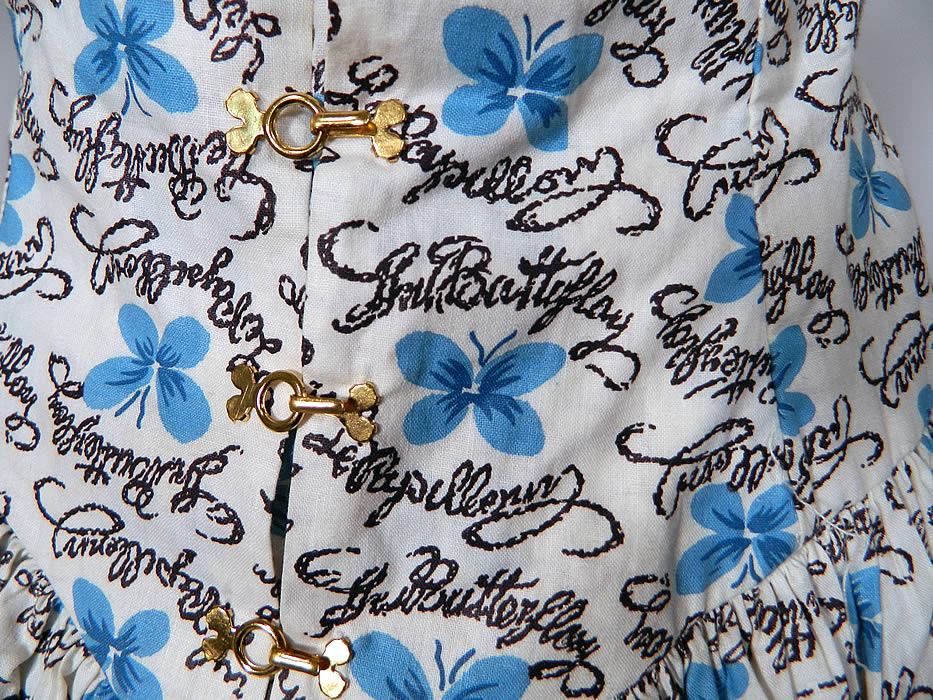 Vintage Blue Butterfly Papillon Print Cotton Circle Skirt Summer Sun Dress. This sensational summer sun dress has blue trim spaghetti straps, pleated gathering on the front neckline, a fitted drop waist with gold clasp hooks, a full circle skirt and back zipper closure.