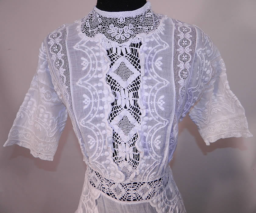 Edwardian Embroidered White Cotton Batiste Lace Graduation Wedding Dress. It is made of a fine white cotton batiste lawn fabric, with raised padded satin stitch embroidery work and crochet, filet, valenciennes bobbin lace inserts.