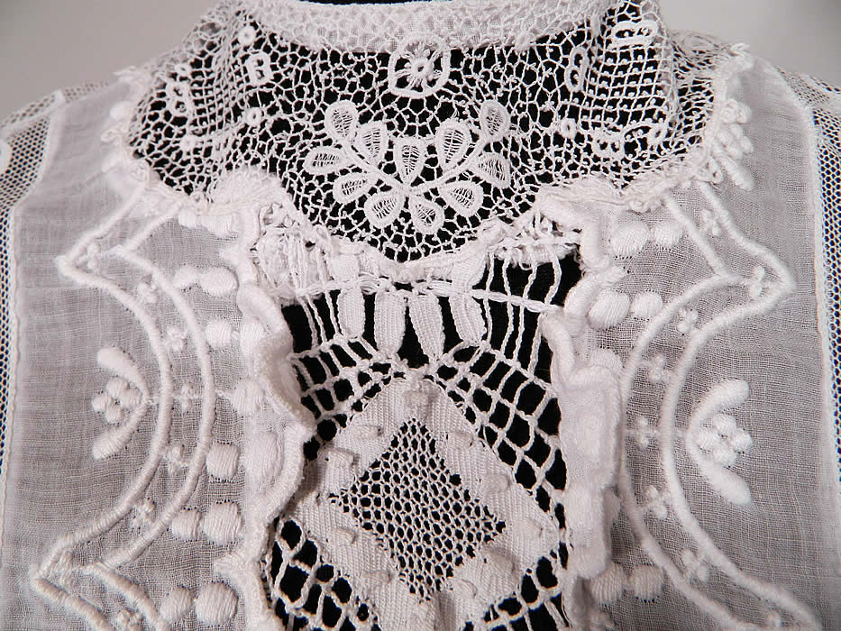 Edwardian Embroidered White Cotton Batiste Lace Graduation Wedding Dress. This lovely lace lawn dress is a long tea length, with short sleeves, a fitted waist, button back closures and  is sheer, unlined.