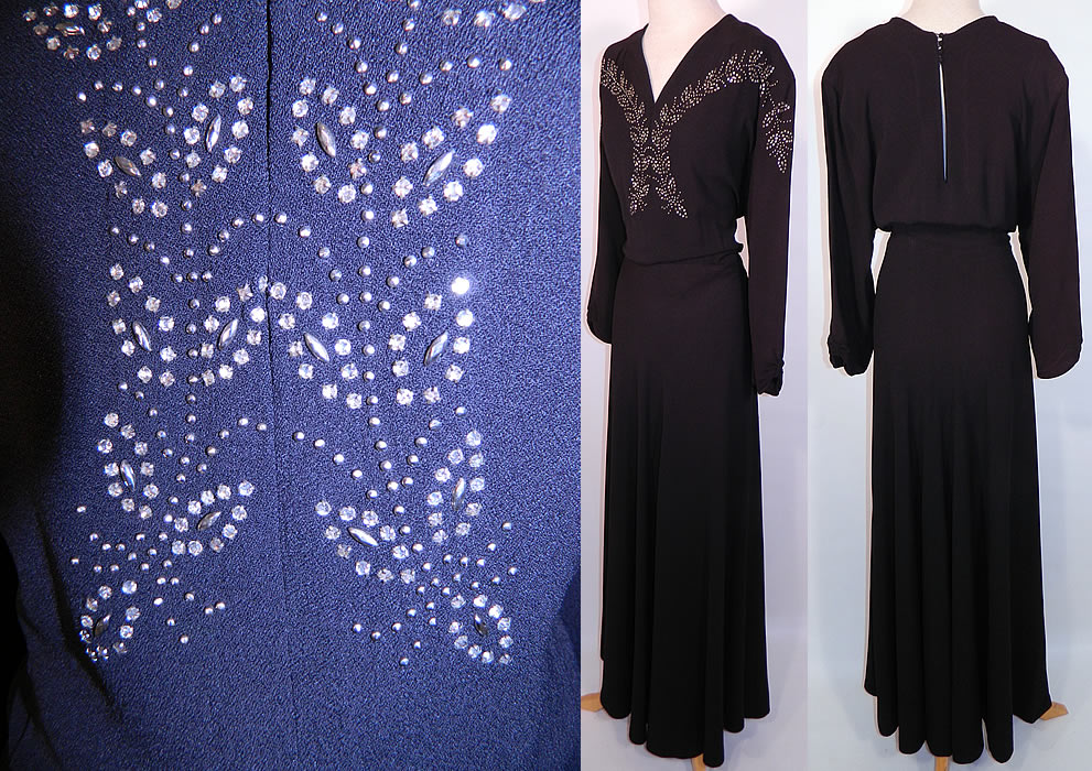 Vintage Black Silk Crepe Silver Studded Rhinestone Beaded Evening Gown Dress. This elegant evening gown floor length dress has a V front neckline, a key hole opening back with button closures on the neck, long full sleeves, a long full skirt and side zipper closure...