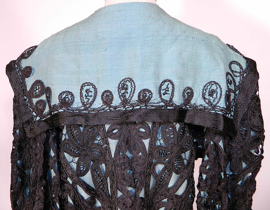 Edwardian Turquoise Blue & Black Silk Battenburg Tape Lace Coat Jacket. The coat measures 35 inches long, with 42 inch hips, a 38 inch waist,  40 inch bust, 14 inch back and 20 inch long sleeves.