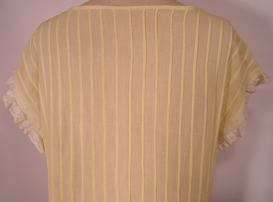 Vintage Pastel Yellow Cotton Pleated  Lace Ruffle Chemise Shift Dress.This lovely lace loose fitting chemise style straight shift summer dress has short cap sleeves and is sheer, unlined. The dress measures 45 inches long, with 38 inch hips, a 34 inch waist and 36 inch bust. It is in excellent condition. This is truly a wonderful piece of wearable antique lace art!