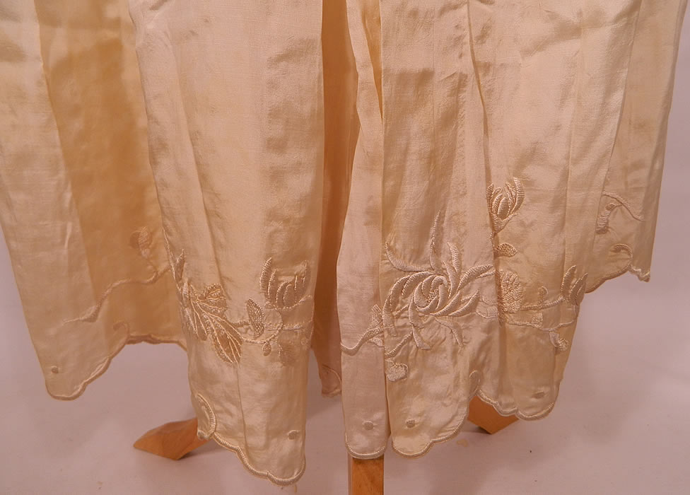 Edwardian Cream Silk  Embroidered Bed Jacket Robe Petticoat Skirt Trousseau. The jacket measures 21 inches long, with  a 46 inch waist and 46 inch bust. There is a long floor length petticoat skirt with bottom ruffle, scalloped hemline and hook closure on back.