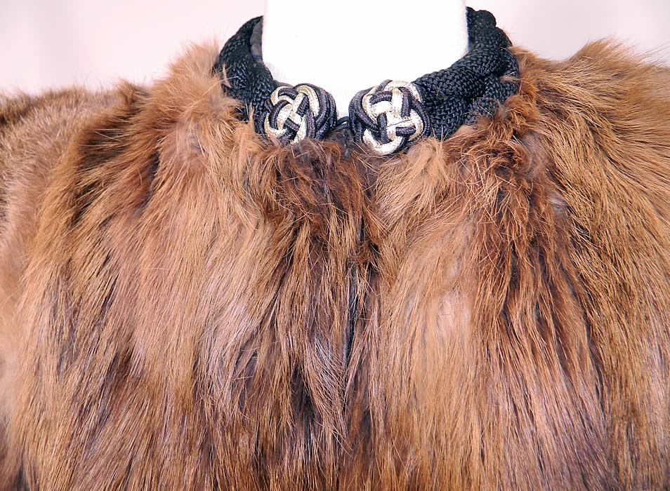 Vintage Muskrat Fur Black Satin Lined Broad Shoulder Winter Coat Jacket. There is a quality black satin fabric lining, in the pockets and under the arm panels, with a heavy black braided woven collar neckline with gold knotted trim on front.