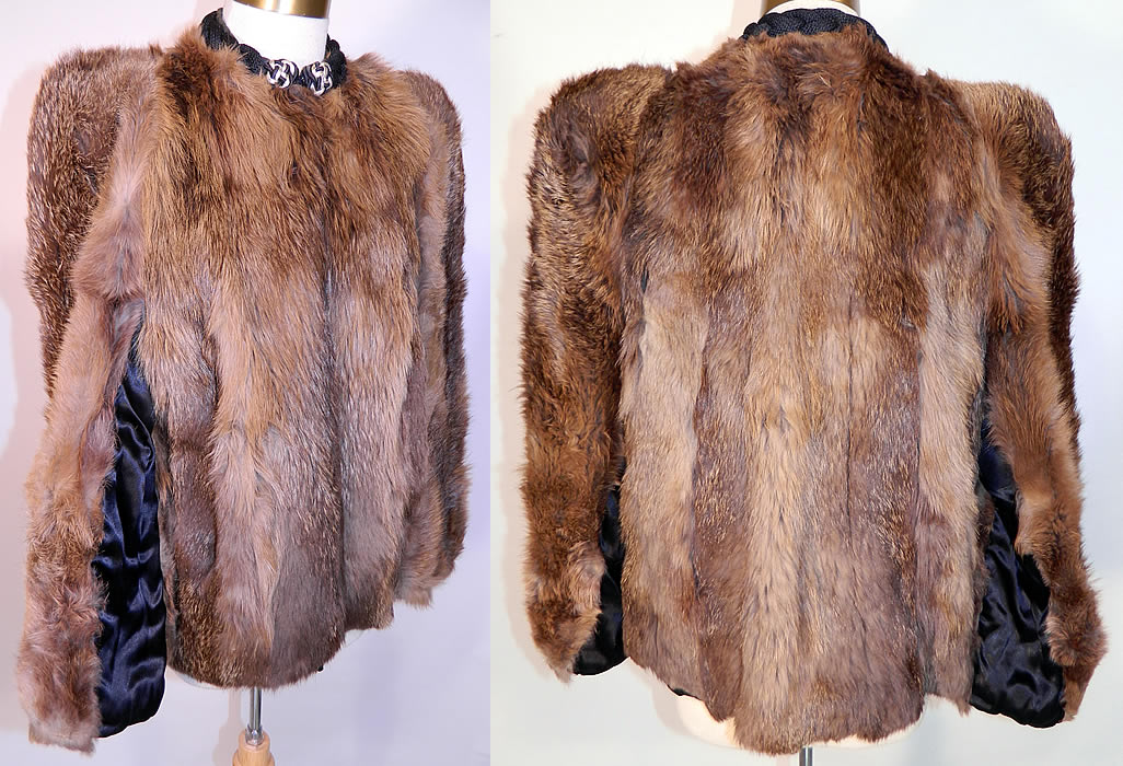 Vintage Muskrat Fur Black Satin Lined Broad Shoulder Winter Coat Jacket. This wonderful winter fur coat jacket is mid length, with a loose fitting boxy style, broad shoulder padding, long full sleeves, side pockets, hook closure on the front neck and is fully lined.