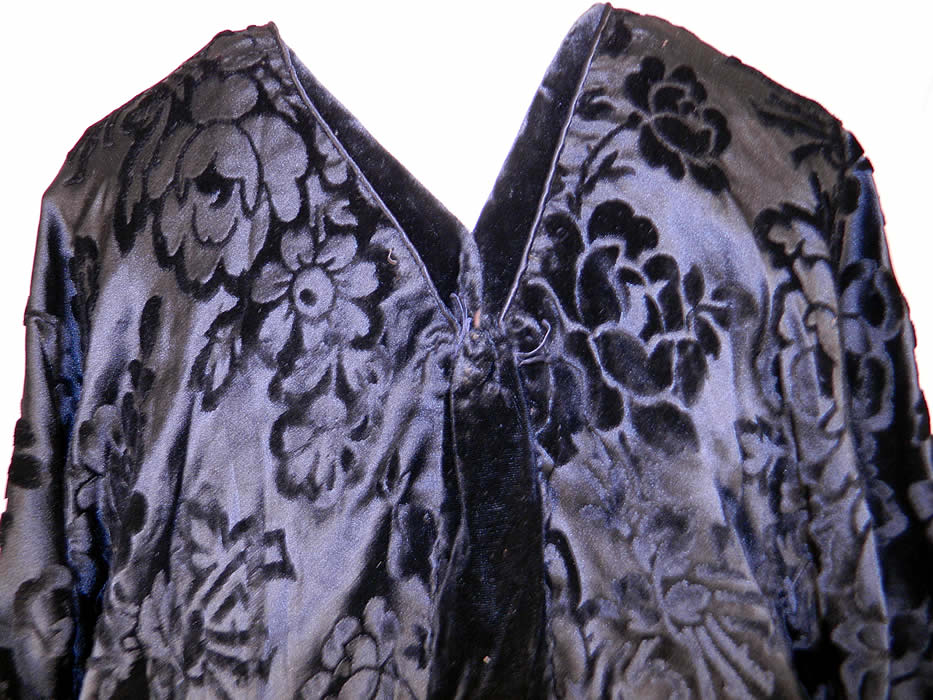 Vintage Black Floral Burnout Voided Velvet Silk Bias Cut Evening Gown Dress. The dress is a large size measuring 60 inches long, with 50 inch hips, a 38 inch waist, 40 inch bust and 20 inch back. It is in good condition. This is truly a wonderful piece of wearable textile art!