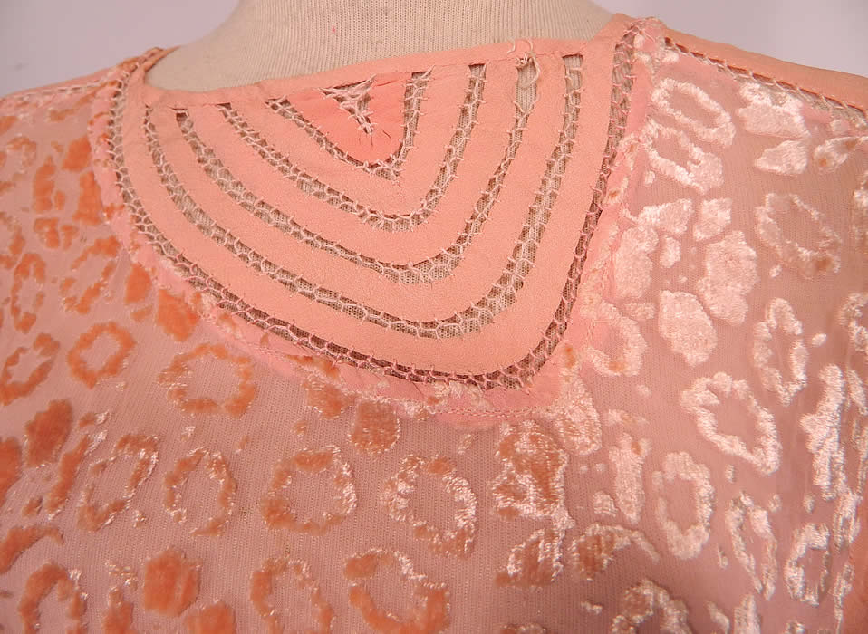 Vintage Art Deco Pink Pastel Silk Burnout Voided Velvet Drop Waist Flapper Dress. This fabulous flapper dress has a loose fitting drop waist style, long sheer sleeves, velvet trim cuffs, an asymmetrical neckline made of pink silk ribbon drawn cut work, side sash skirt trim and is unlined.