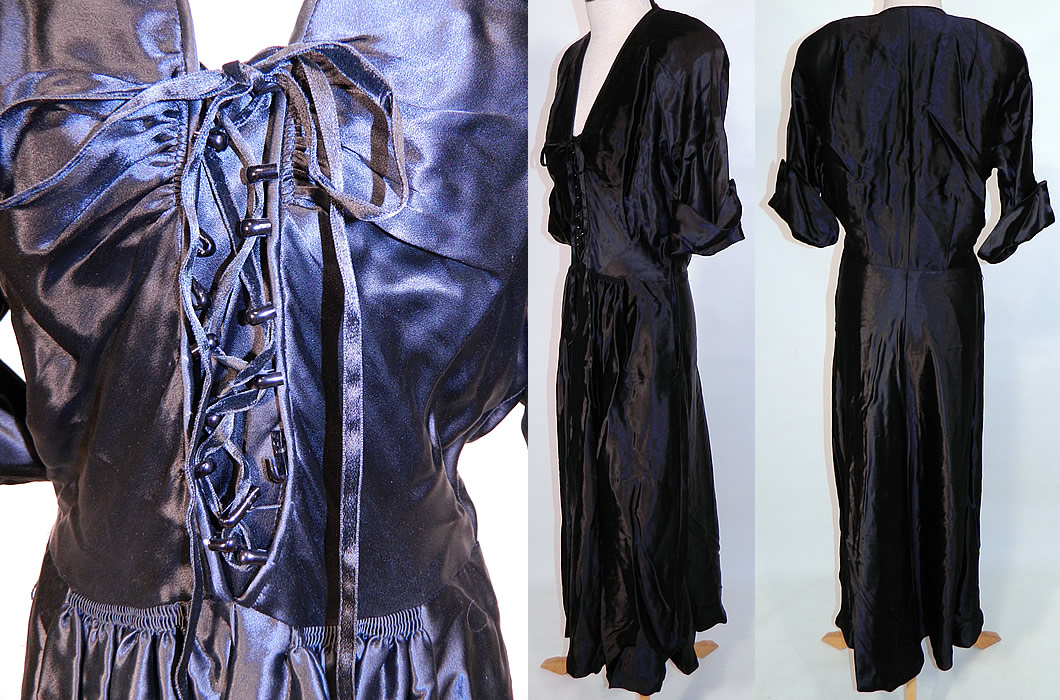 Vintage Black Silk Satin Corset Lace-up Front Neckline Evening Gown Dress. The dress measures 50 inches long, with a 26 inch waist, 36 inch bust and 15 inch back. It is in good condition, has not been cleaned. This is a wonderful piece of wearable art!