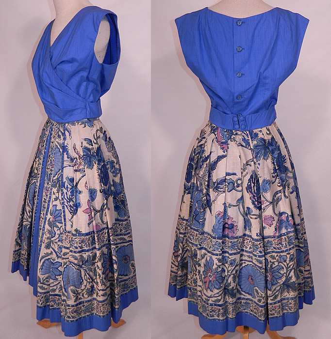 Vintage Tabak of California Sanganer India Hand Block Print Cotton Circle Skirt Dress. This sensational summer sun dress two piece outfit has a blue blouse top, with a wrap front style, attached sash belt with hooks on the back, sleeveless and button back closures.