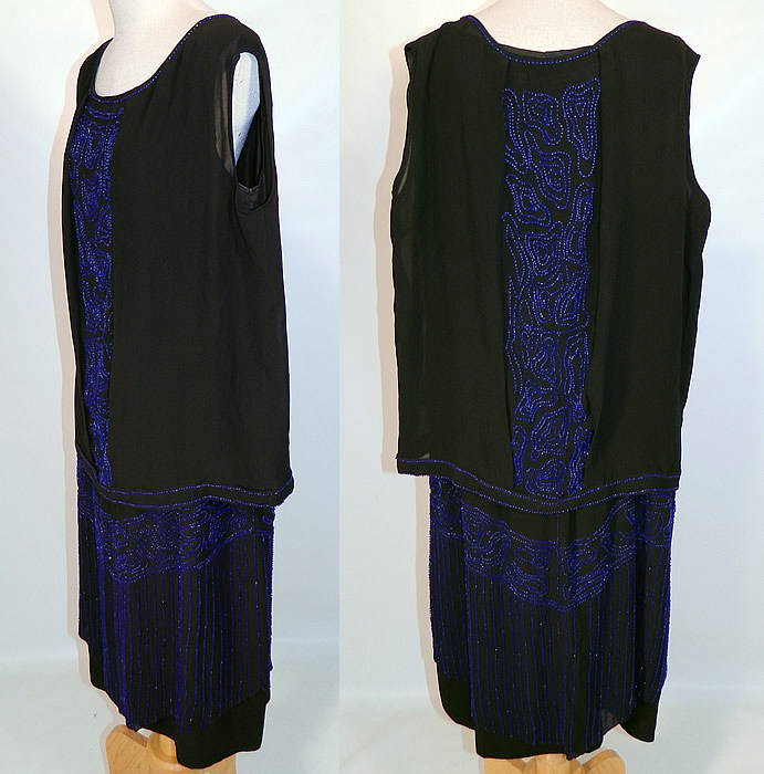 Vintage Art Deco Black Silk Cobalt Blue Beaded Drop Waist Flapper Dress. The dress measures 40 inches long, with 38 inch hips, a 36 inch waist and 36 inch bust. It is in good condition, with only a few loose missing beads. This is truly a wonderful piece of Art Deco wearable beaded textile art!