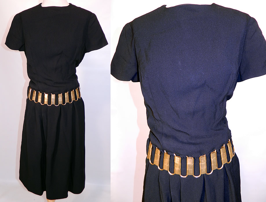 Vintage Christian Dior Paris Gold Chain Link Belted Black Cocktail Dress. This amazing vintage Christian Dior Paris gold chain link belted black cocktail dress dates from the 1960s.