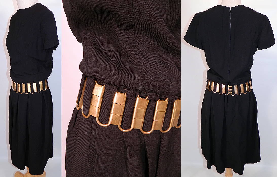 Vintage Christian Dior Paris Gold Chain Link Belted Black Cocktail Dress. It is made of a black acetate fabric, with a heavy gold brass chunky chain link belt hand sewn and woven around the waist.