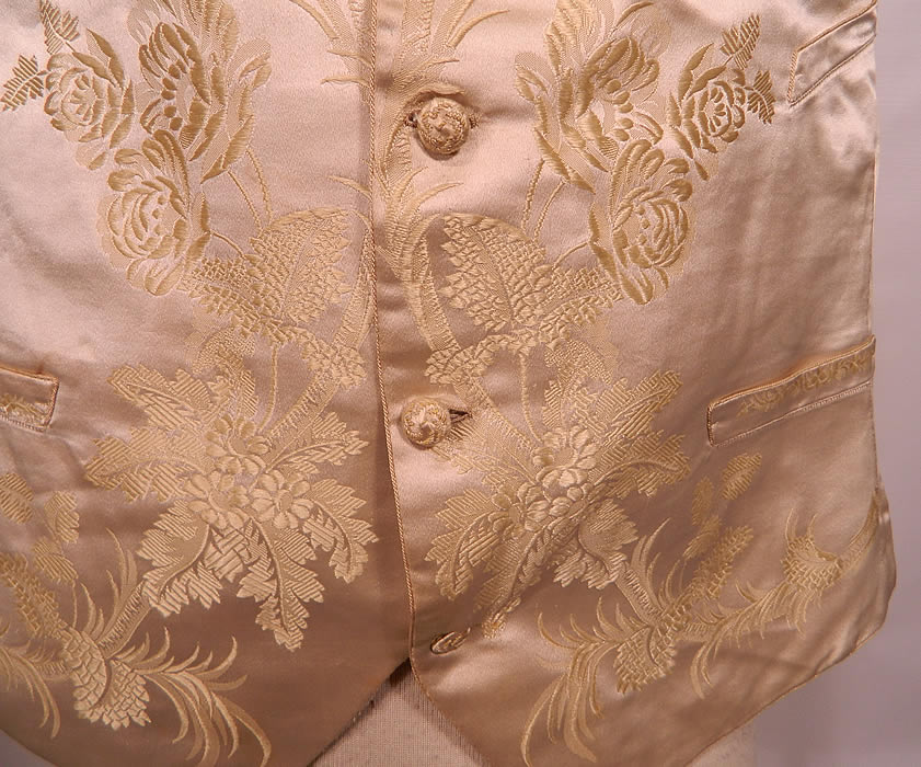 Victorian Gentlemen's White Silk Damask Floral Brocade Wedding Waistcoat Vest. It is hand stitched and made of an off white ivory color silk damask botanical floral embossed brocade fabric.