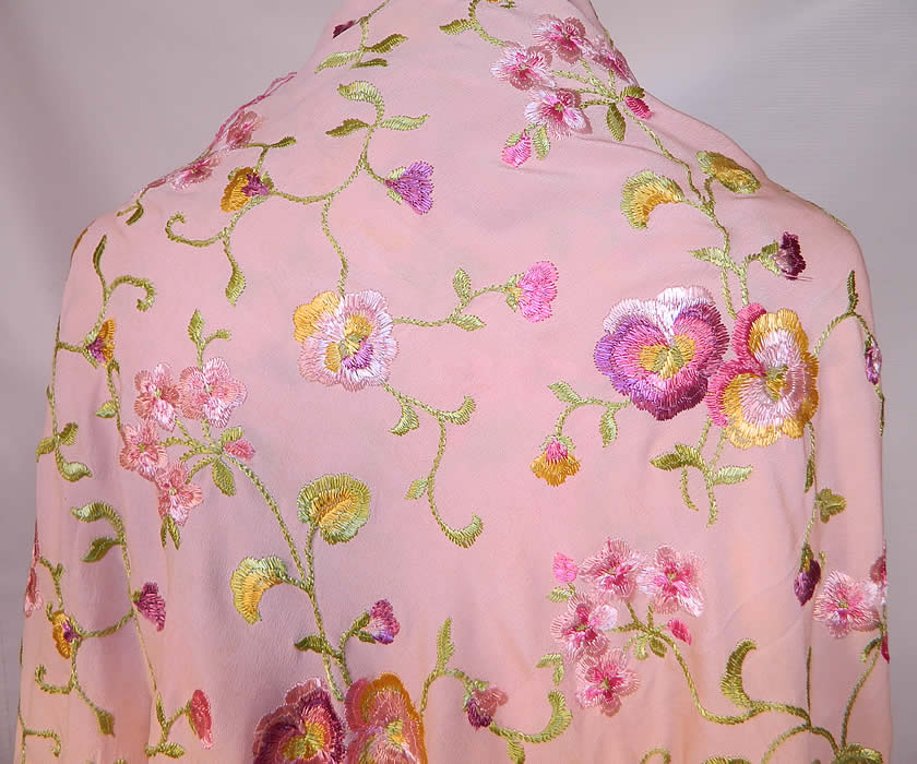 Vintage Pastel Pink Silk Floral Pansy Embroidered  Flapper Boho Piano Shawl. There is matching pink hand knotted silk fringe which measures 17 inches long surrounding the entire shawl. The shawls fabric square measures 52 by 52 inches.