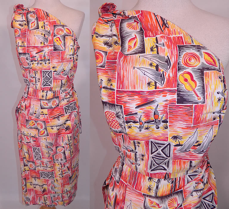 Vintage Hawaiian Surfer Pineapple Print Cotton Off One Shoulder Sarong Dress. This vintage Hawaiian surfer pineapple print cotton off one shoulder sarong dress dates from the 1950s. It is made of a cotton fabric with bright golden yellow, orange, red colors and a black & white Hawaiian tropical print with surfers, sail boats, outrigger canoes, pineapples and seashells.