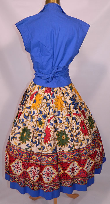 Vintage Tabak of California Sanganer India Hand Block Print Cotton Circle Skirt Dress. Included is a full circle skirt, with pleating around the waist, a matching blue fabric on the front panel and bottom hem trim, with button closure waistband.