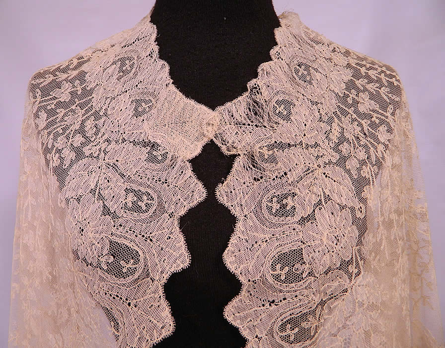 Victorian Civil War Antique Blonde Chantilly Lace Mantilla Shawl Cloak Cape. It has been created into a large cloak cape shaped shawl style wrap with a rounded neckline, front opening and no closure.