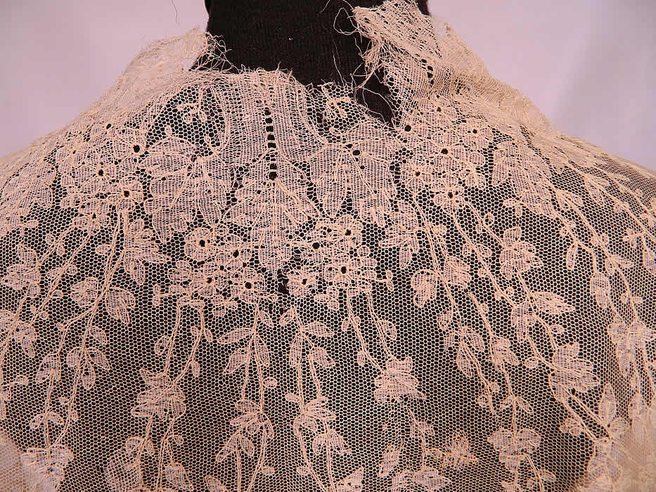 Victorian Civil War Antique Blonde Chantilly Lace Mantilla Shawl Cloak Cape. The shawl measures 43 inches long, 83 inches wide and has a 20 inch neck. It is in as-is fragile condition, with a frayed back neck and several small holes scattered (see close-ups). This is truly a rare and wonderful piece of antique Victoriana lace art!